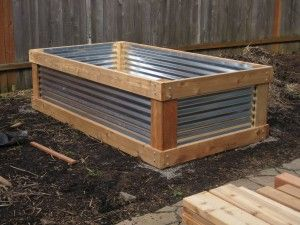 Raised bed made with galvanized steel sheeting.  Much lighter and cheaper!!