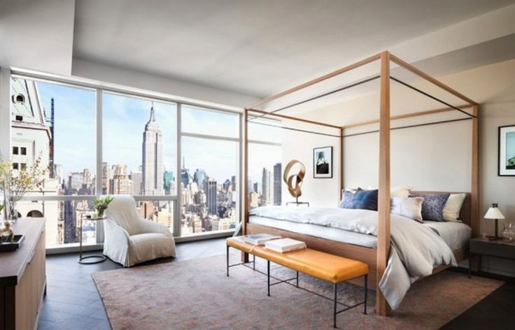 Apartment: Awesome Master Bedroom Design Ideas With Four Post Bed Also Orange Leather Bench Plus White Fabric Armchairs Plus Brown Contemporary Rugs Also Wooden Cabinet And Massive Glass Windows: Awesome Apartment At New York City By Famous Home Designer