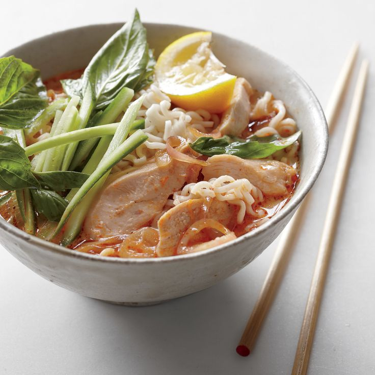 Inspired by Malaysian laksa, a traditional dish of noodles in hot spicy broth, this easy-to-prepare soup gets its complex flavor foundation from store-bought curry paste. It can be topped with cooked chicken (such as the Chicken with Basil and Lime), seafood, or tofu. Try other traditional garnishes, such as scallions, cilantro, chiles, peanuts, or hard-cooked eggs.