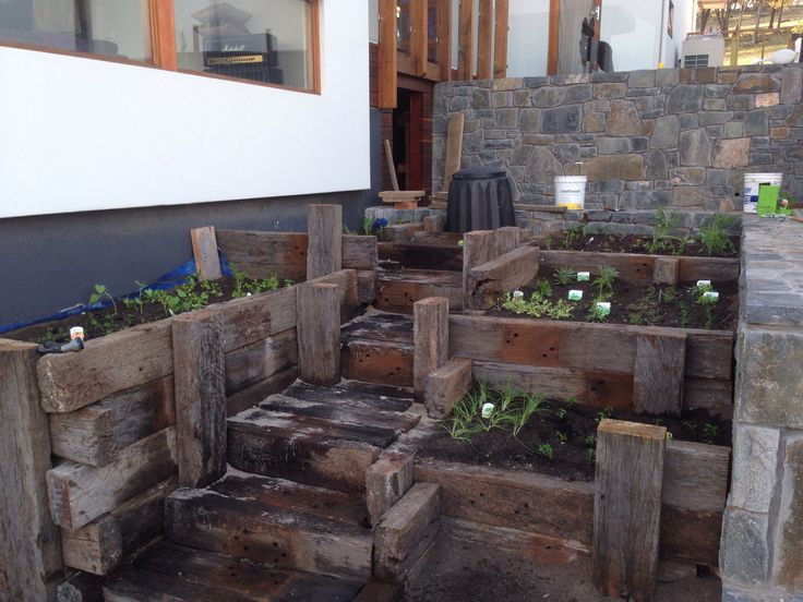 Old railway sleepers as a cascading garden and vegetable patch.