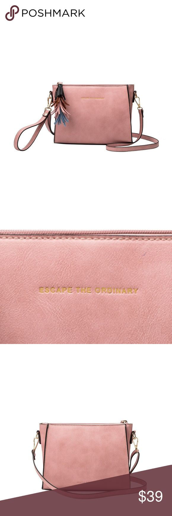 """Melie Bianco Byron Quote Crossbody Melie Bianco Byron Quote Crossbody.                          Premium Vegan Leather Middle Zipper Interior Zipper Pocket Additional Wristlet Strap Included Gold Embossing """"ESCAPE THE ORDINARY"""" Dimensions: 9'L x 3'W x 6H' Color: Pink Melie Bianco Bags Crossbody Bags"""