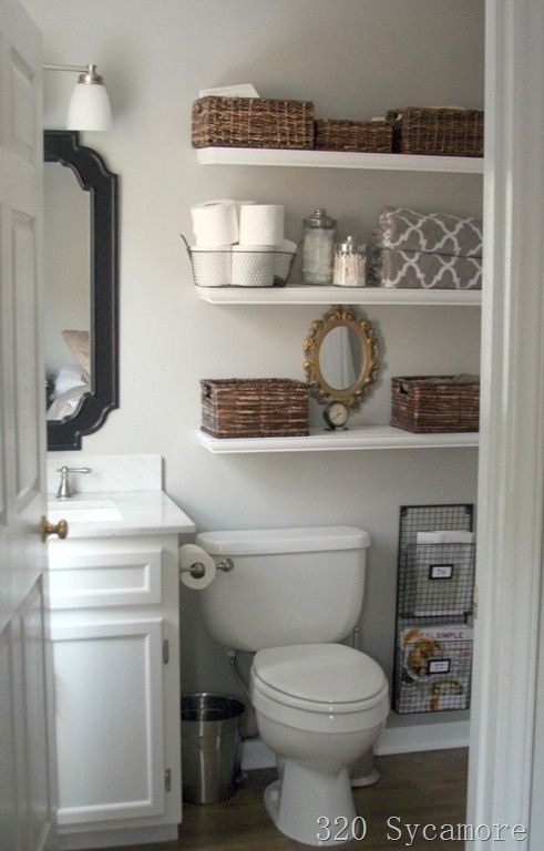 Small bathroom makeover - like the floating shelves for above toilet