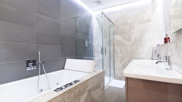 This spacious bathroom is kitted out with a bath and a shower, and is just waiting for a family to visit London and stay in Kensington!