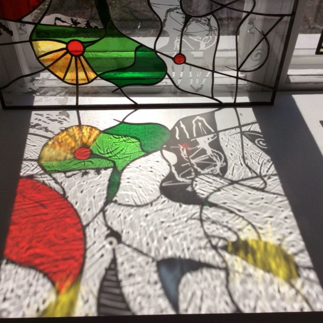 A shade of a stained glass.  Coloured glass / sandblasted clear glass.