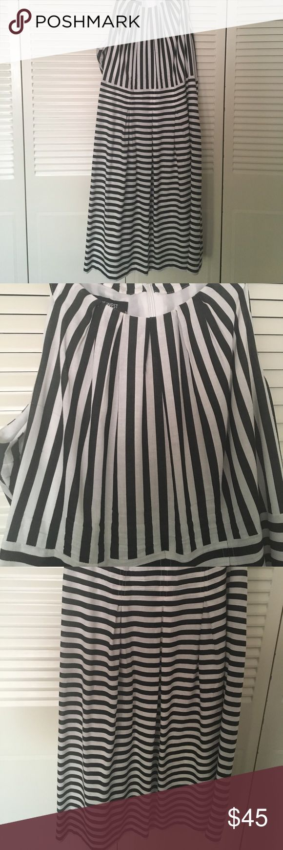 Black and white striped dress with pockets! Tea-length dress worn twice (once for under an hour). High neck that resembles a halter top, and no stains/damage/etc. Plus, it has functional pockets! Nine West Dresses Midi