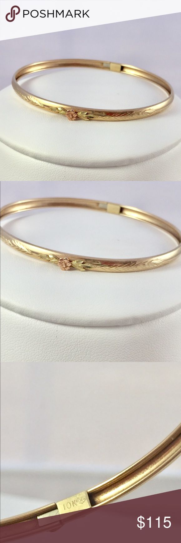 NWT 10kt gold bangle rose gold flower & engraving Brand new with tags 10 kt yellow gold bangle with rose gold flower motif and engraving. Well made piece and it does not flex. The ends of the bracelet twist slightly to allow you to put it on your wrist. Very classic style and will always be fashionable. Secure clasp slides in and has a locking hinged clasp.  Price is firm and what a steal. The perimeter (length) of the bracelet is 7.5 Fine Jewelry Jewelry Bracelets