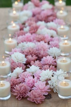 So pretty! Group a bunch of lotus flowers, lined with candles on the side, for a romantic festive moment.