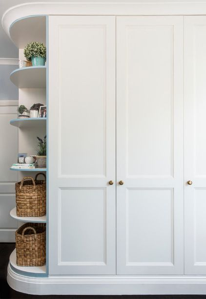 "Designer: Lisette Voûte of Lisette Voûte Designs | Voûte designed floor-to-ceiling storage for the master bedroom, and added curved shelves to prevent it from looking too solid. ""Now the wardrobes don't darken the entrance to the room or appear to block it,"" she says."