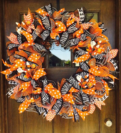 Make your own version of Halloween mesh ribbon wreath with our tutorial. Adorn your home with this wreath to bring a Halloween punch.
