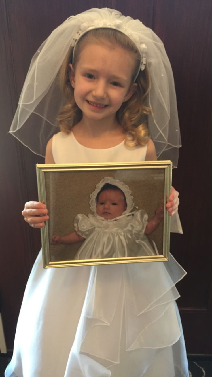 First Communion pic- while holding the baptism pic!!