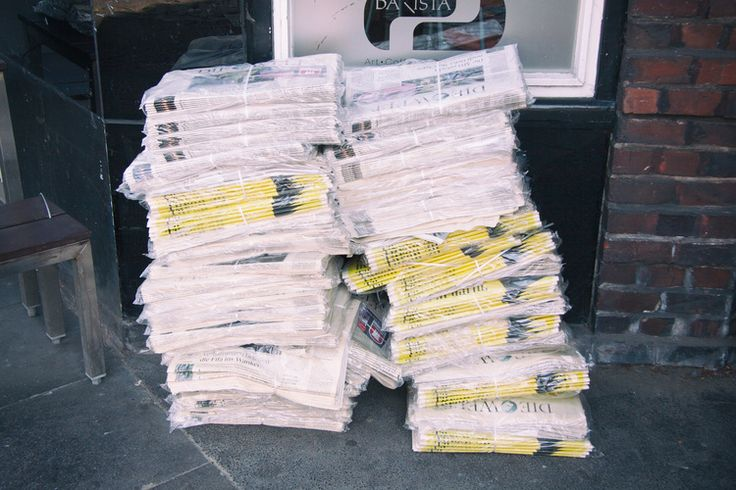 Stack of newspaper on street http://barnimages.com/