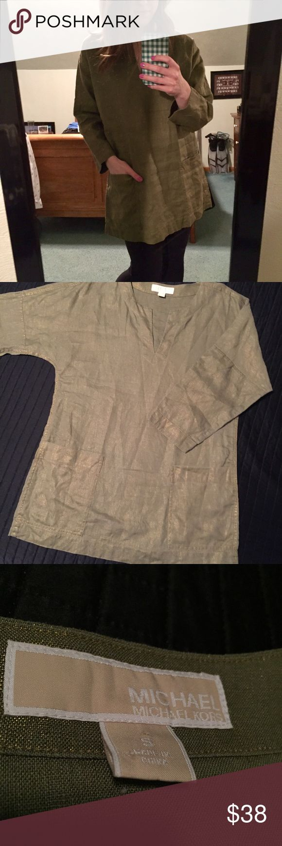 Michael Kors Linen Smock Tunic Top Michael Kors army green with subtle gold shimmer smocked linen top with v-neckline and pockets! Sleeves are almost full length. Flawless condition!! Very versatile, can be paired with leggings or belted, lots of possibilities for styling this piece! MICHAEL Michael Kors Tops Tunics