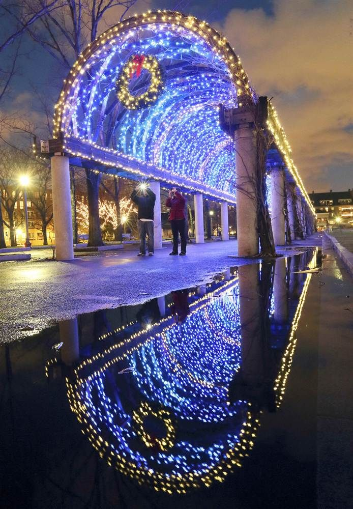 Holiday lights adorn a walkway in Christopher Columbus park on the waterfront in Boston, Dec. 21.