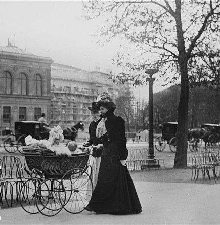 Walking down the Champs-Elysées, Paris,1900.