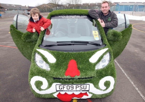 This is a great shot of a little boy who won a competition to design a fake grass covered car ... http://www.northantset.co.uk/news/alfie_s_design_chosen_as_face_of_grassy_car_1_3520623#