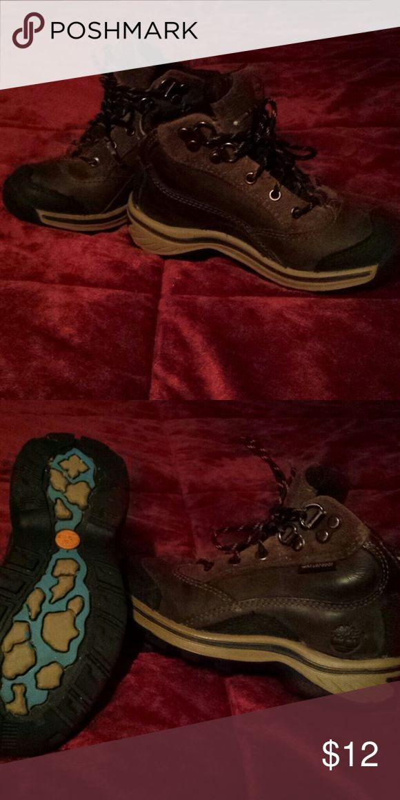 Boys Timberland boots Very cute boys Timberland boots! Size 10. Waterproof. Outside of shoe is part leather part suede different shades of brown with black on the top front. Great boots for the cold weather! Still in very good condition! Timberland Shoes Boots