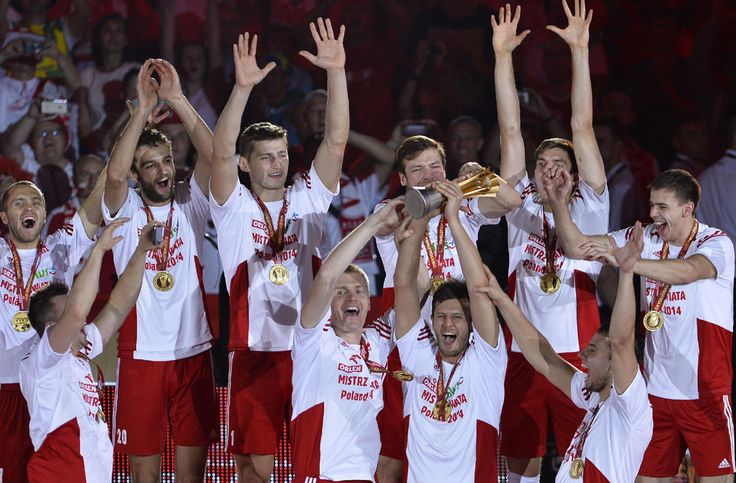 Polish players celebrate with the trophy during the decoration ceremony following their win over Brazil in the FIVB Men's Volleyball World Championships final game between Brazil and Poland in Katowice, Poland, Sunday, Sept. 21, 2014