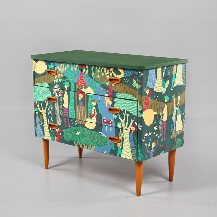 "Swedish re-design. Three drawers from the 50s, green painted, upholstered in fabric ""Paradise/ Lustgården"" by Stig Lindberg."