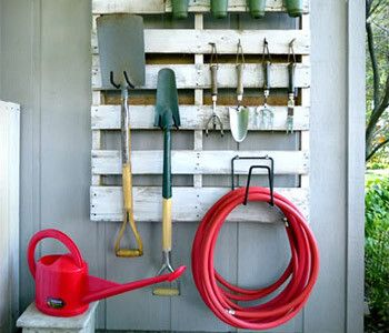 2. Pallet Hanging Storage  Here's another fun outdoor DIY storage solution: With the addition of hooks and a hose holder, a freebie wood pallet becomes the perfect spot to hang all sorts of garden and yard supplies.