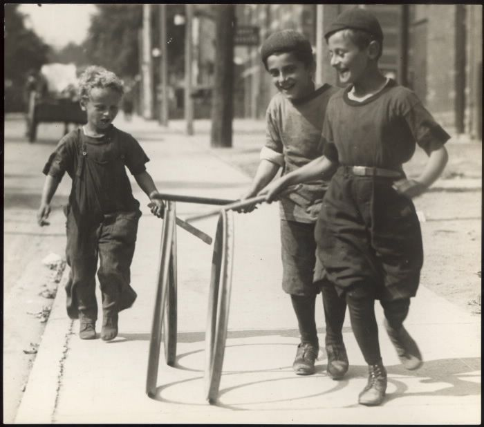 Boys of 3 different ethnicities (Greek, Hebrew, Polish) hoop rolling on the sidewalk in Toronto. 1922. via Toronto Public Library.