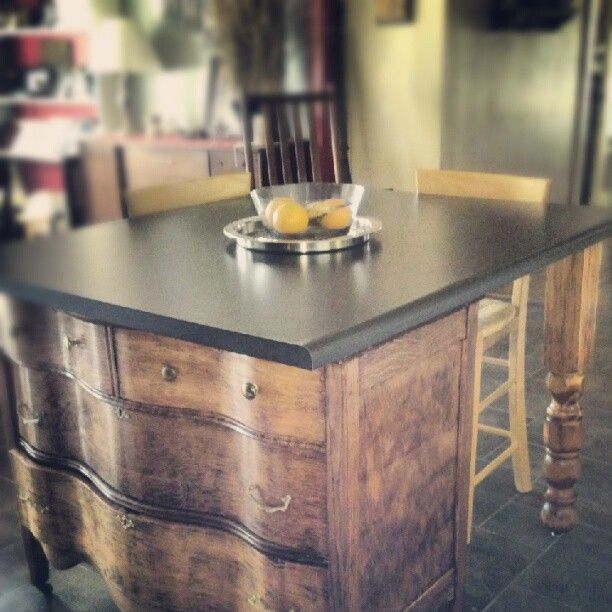 kitchen island = refinished dresser +  legs from bedframe + countertop