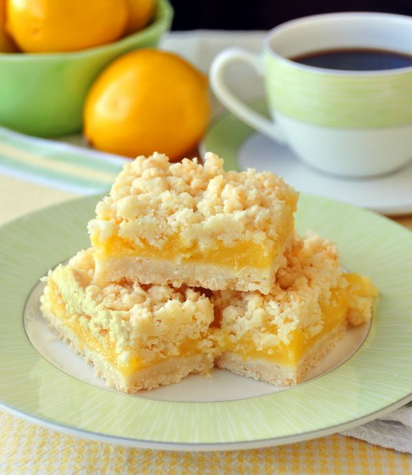 LEMON COCONUT CRUMBLE BARS. Ingredients: 2 cups flour + 3/4 cup sugar + 1 tsp baking powder + 2 cups dried coconut, medium cut + pinch salt + 1 cup butter, cut in small pieces. For the lemon filling: 1/3 cup cake flour + 1/3 cup corn starch + 1 1/2 cups sugar + 5 egg yolks, slightly beaten + Zest of 2 large (or 3 small) lemons, very finely chopped + Juice of 2 large (or 3 small) lemons + 2 cups water + 3 tbsp butter + pinch salt