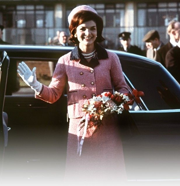Jackie wore the suit on at least six occasions prior to President Kennedy's assassination in Dallas. Below she is seen wearing the suit on a official trip to London (March 1962).