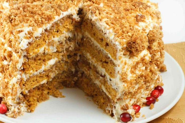 Four layer pumpkin crunch cake with a cream cheese frosting