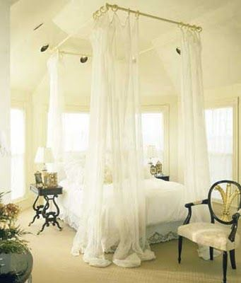 DIY Canopy Bed. Install curtain rods on the ceiling over the bed. Instant canopy look! Doing This!!!
