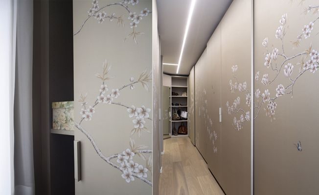 Closet doors with Misha's modern chinoiserie, Oriental wallpaper design on Turtle Dove dyed silk.