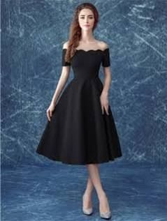 tea length black dress with sleeves