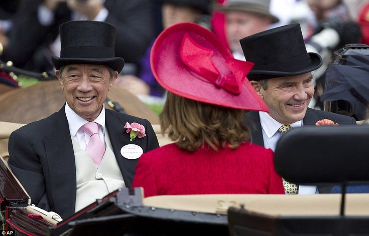Guests of honour: The Middletons were in the fourth carriage, accompanied by Ronald Arculli, left, former head of the Hong Kong stock exchange and head of the Hong Kong Jockey club.