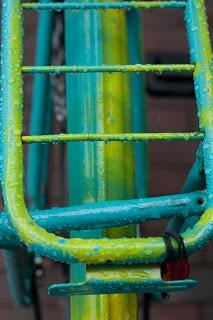 Blue/yellow = green bike in the rain.