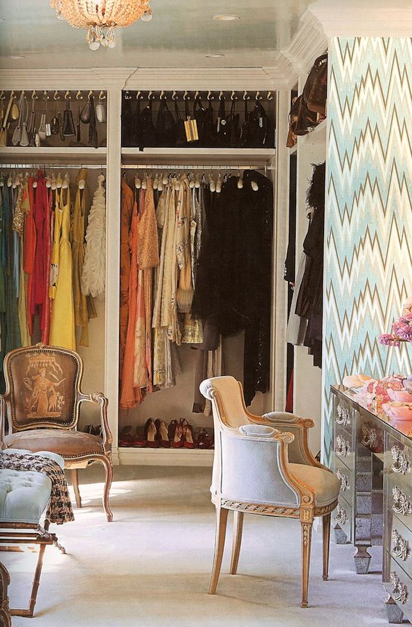 Look At Those Hooks For Handbags . A Luxurious Dressing Room/closet  Combination Features Organized Closets.and A Dressing Table For Primping.