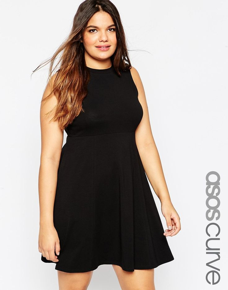I think that maroon dress you tried on was the most flattering - it was structured jersey and the waist sat a little higher. You should look for variations on that dress, like this one, which changes the details but is the same basic shape.