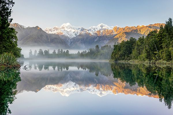 Lake Matheson, near the Fox Glacier in South Westland, New Zealand, is famous for its reflected views of Aoraki/Mount Cook and Mount Tasman.  #newzealand #nz #travel #traveling #nature