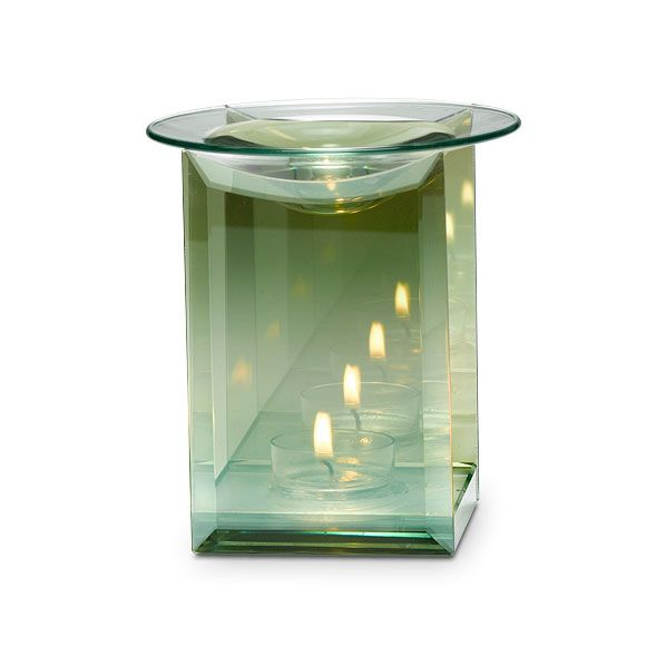 """Reflective surfaces on front and back panels create multiple points of light from burning tealight, sold separately. Glass dish holds Scent Plus® Melts, or Scented Oil sold separately. 5""""h, 4""""w."""