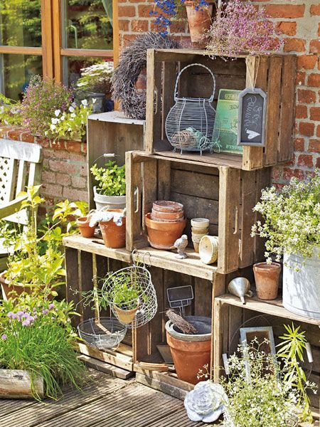 What a cute way to have home made shelving outside!