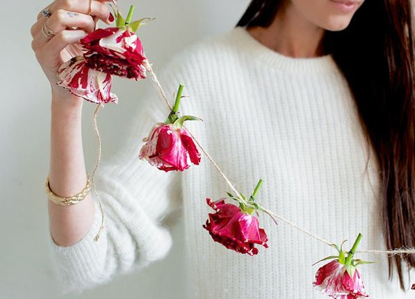 Make your own rose party garland.  A perfectly gorgeous and simple-to-achieve party decoration.