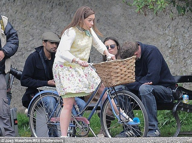 Ready to fall: The actress didn't look too confident as she took to two wheels on set...