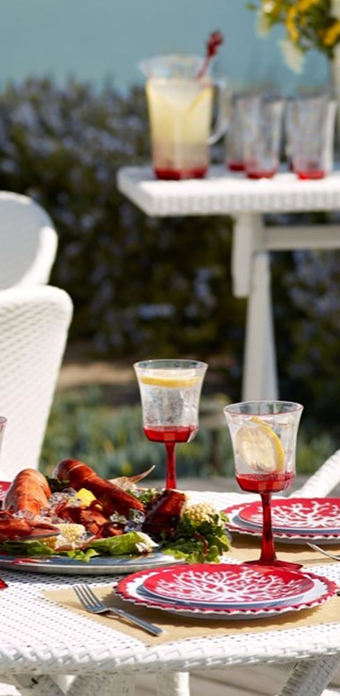 The coral hue of the Kim Seybert Coral Drinkware Collection brings the taste of the tropics right to your backyard or beach house.