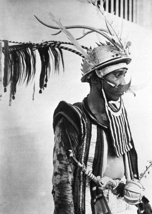 Nias (Indonesia) warrior wearing a takula tofao (battle helmet).