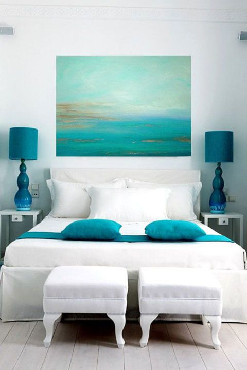 25 interior design ideas for a beach house: Aqua colored throw pillows and aqua lamps go well with this decadent white bedding
