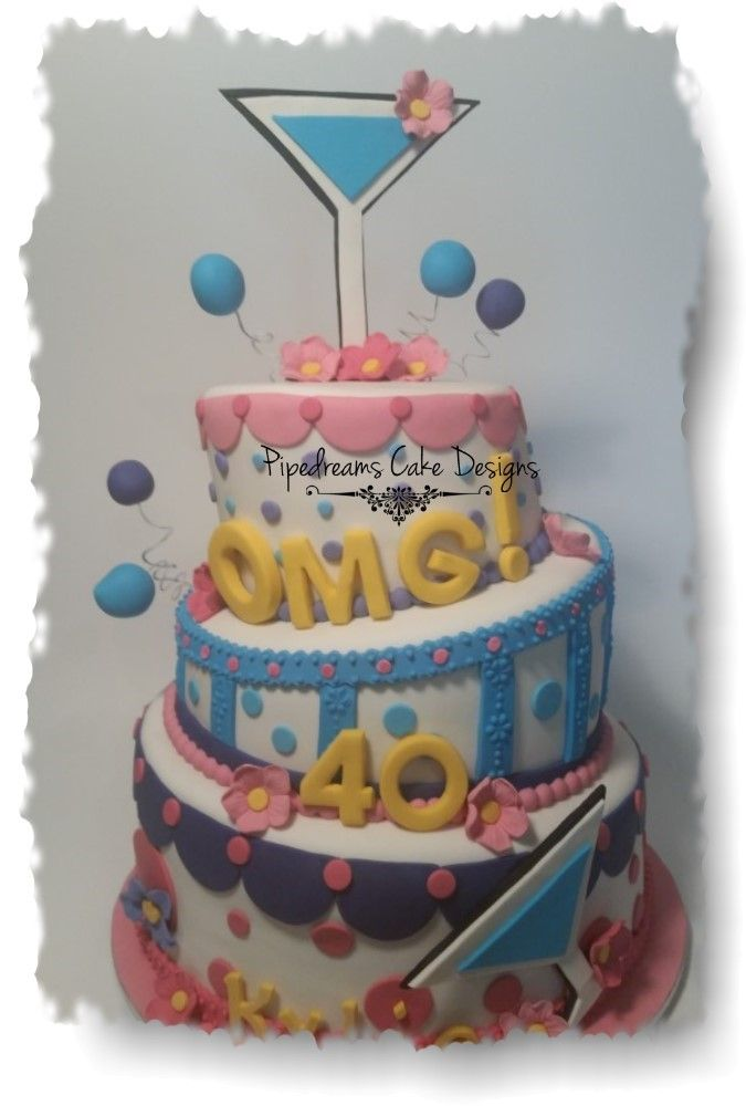 A fun 40th birthday cake. A 3 tier Topsy Turvey cake decorated in pink, blue and purple with a Cocktail glass topper.