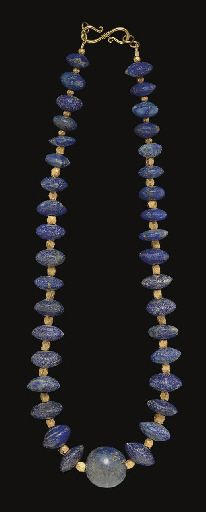 A WESTERN ASIATIC LAPIS LAZULI BEAD NECKLACE CIRCA 3RD-2ND MILLENNIUM B.C. Composed of thirty-six convex-biconical lapis lazuli beads, graduated in size, centered by a spherical lapis lazuli bead, interspersed with modern faceted gold beads; strung with a modern S-hook closure 18 in. (45.7 cm.) long