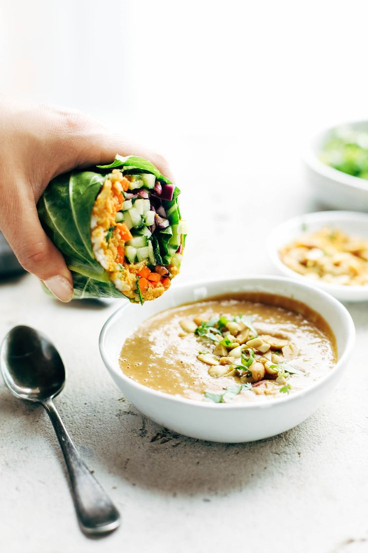 Detox Rainbow Roll-Ups - with curry hummus and veggies in a collard leaf, dunked in peanut sauce