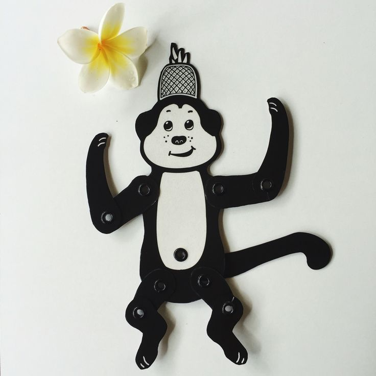 A funny monkey ready to play :) You can find if in my shop: http://blackcatwhitehare.etsy.com