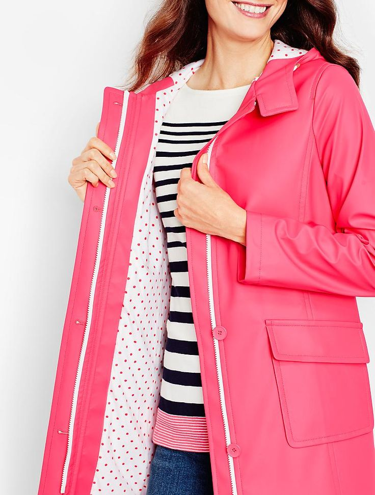 A pink raincoat with a peek of polka dots is cheery and chic.