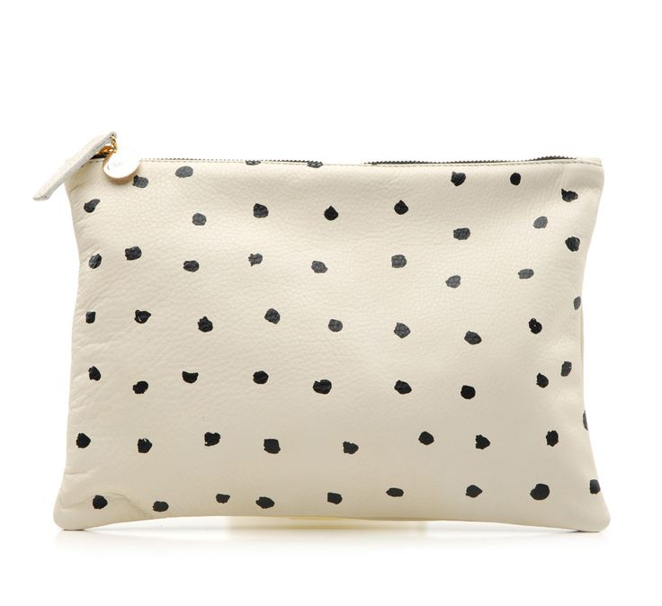 The large flat clutch in dots is new this season by Clare V.   It's is a charming take on a classic staple.   Who does not love dots ?   Great with a suit or jeans.   Year round, day to night...  • ...