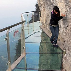 Tianmen Mountain in is a very popular tourist attraction because of the Glass sky walk, located 4,690 feet above the sea level on the side of the Tianmen Mountain in Zhangjiajie province of China. Walking on this see-through glass is a terrifying and thrilling experience, but definitely not for the faint hearted. If you are afraid of the heights, just don't look down while walking on that Glass. Cool, but no thanks.